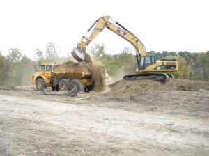 "Great ""action"" shot of a dump truck being loaded up with top soil from a temporary stockpile.  This soil is being moved to a permanent stockpile location."
